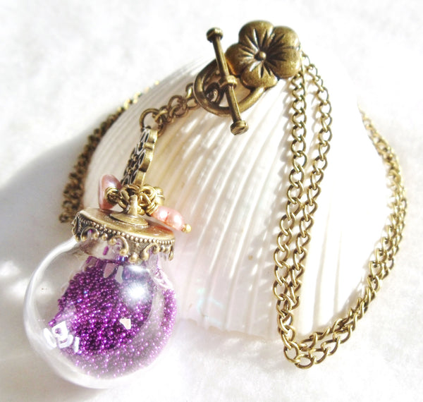 Round glass orb necklace filled with delicate purple fiber beads, hearts and bronze chain - Char's Favorite Things - 3