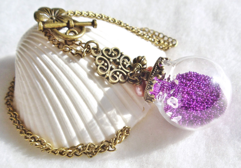 Round glass orb necklace filled with delicate purple fiber beads, hearts and bronze chain - Char's Favorite Things - 1