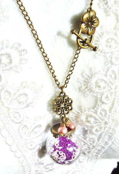 Round glass orb necklace filled with delicate purple fiber beads, hearts and bronze chain - Char's Favorite Things - 2