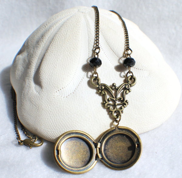 Round locket with bird on front cover adorned with black beads and bronze accents - Char's Favorite Things - 5