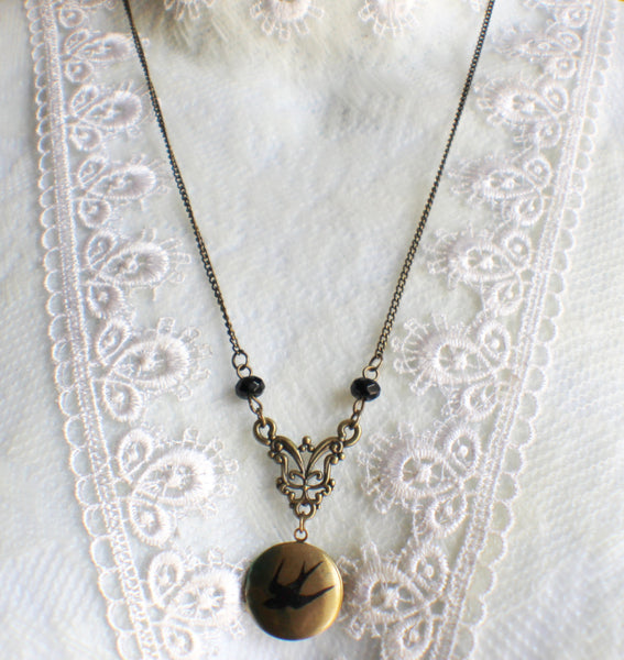 Round locket with bird on front cover adorned with black beads and bronze accents - Char's Favorite Things - 2