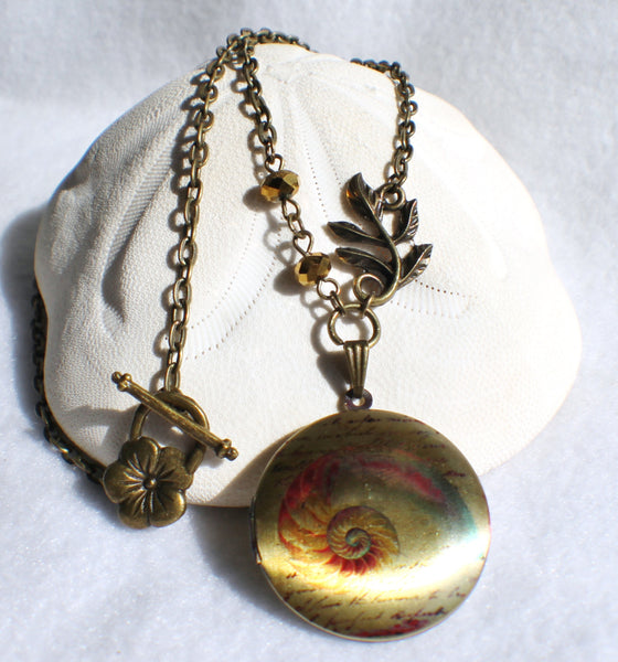 Round locket with seashell design on front cover with bronze faceted beads and bronze accents - Char's Favorite Things - 1