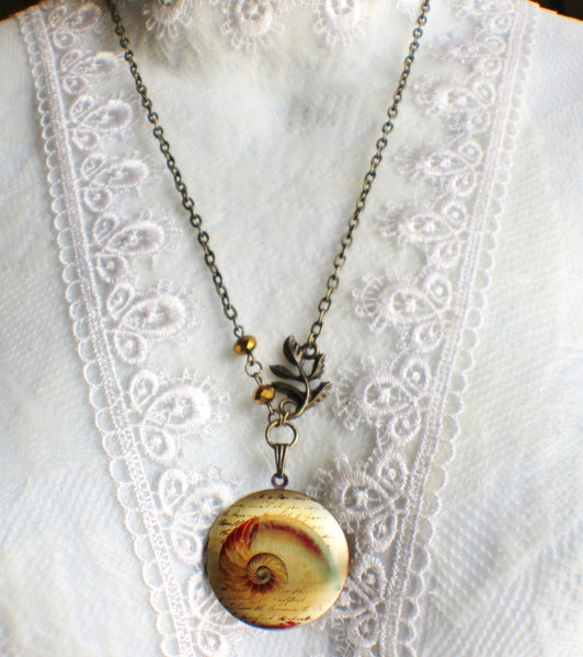 Round locket with seashell design on front cover with bronze faceted beads and bronze accents - Char's Favorite Things - 5