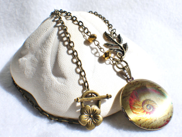 Round locket with seashell design on front cover with bronze faceted beads and bronze accents - Char's Favorite Things - 2