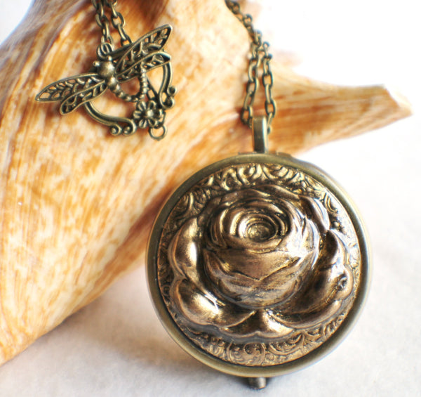 Music box locket,  round locket with music box inside, in bronze with rose on front cover. - Char's Favorite Things - 1