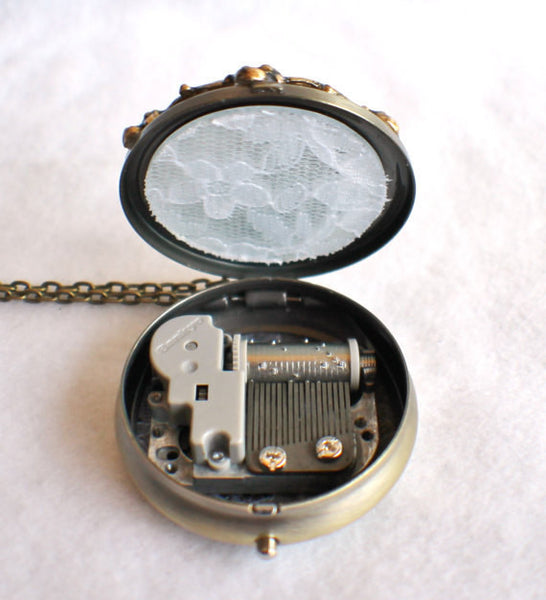 Music box locket, round locket with music box inside, in bronze with maiden in the moon on front cover - Char's Favorite Things - 5