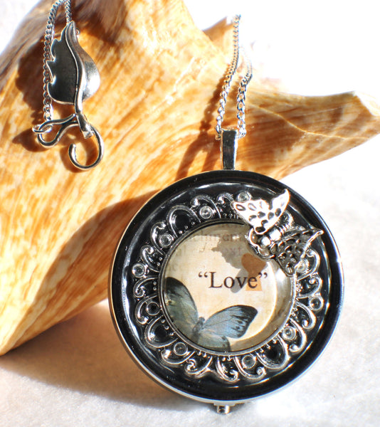 Music box locket,  round locket with music box inside, in silver with Love and Butterfly  Cabochon - Char's Favorite Things - 1