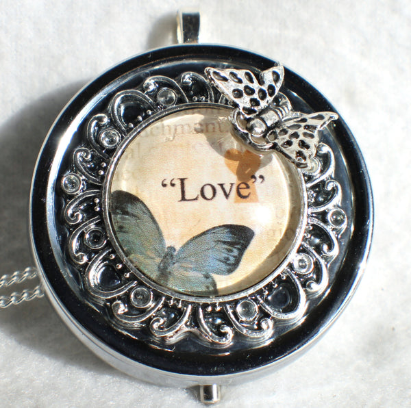 Music box locket,  round locket with music box inside, in silver with Love and Butterfly  Cabochon - Char's Favorite Things - 3