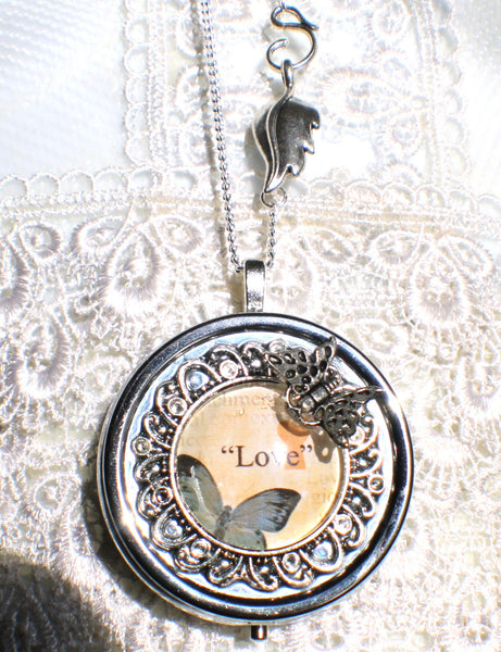 Music box locket,  round locket with music box inside, in silver with Love and Butterfly  Cabochon - Char's Favorite Things - 4