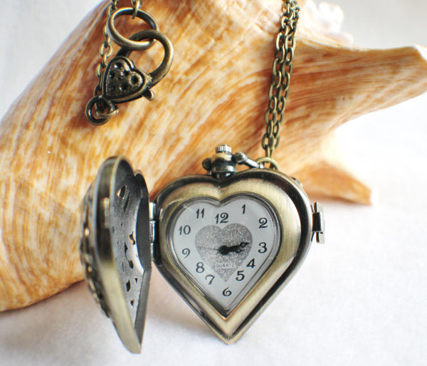 Heart watch locket in bronze with lion head mounted on front cover of watch. - Char's Favorite Things - 4
