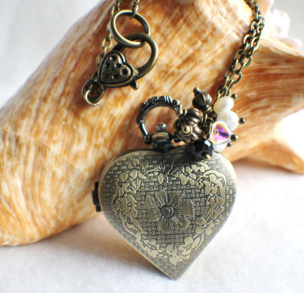 Heart watch locket in bronze with lion head mounted on front cover of watch. - Char's Favorite Things - 5