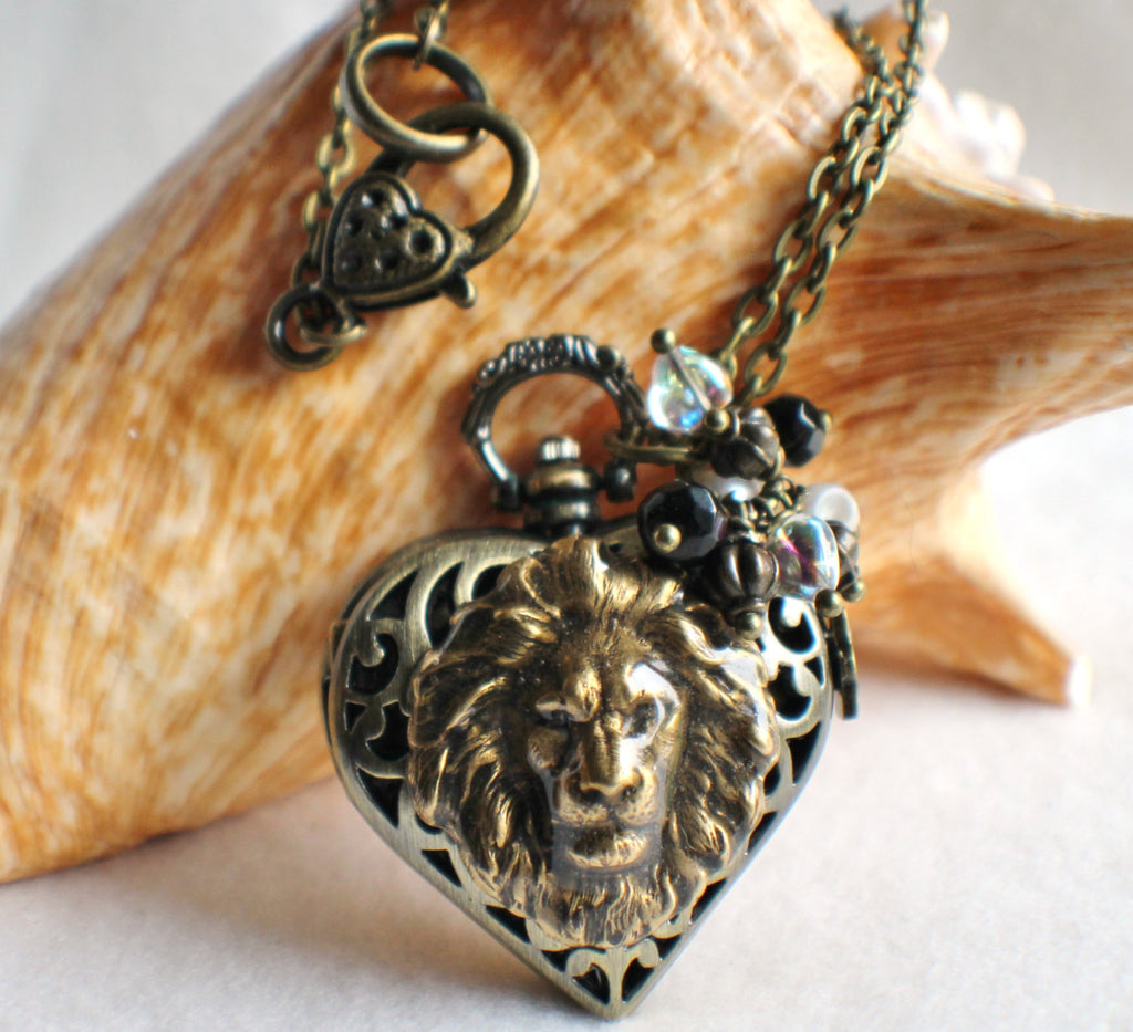 Heart watch locket in bronze with lion head mounted on front cover of watch. - Char's Favorite Things - 1