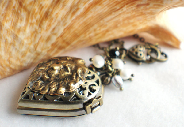Heart watch locket in bronze with lion head mounted on front cover of watch. - Char's Favorite Things - 2