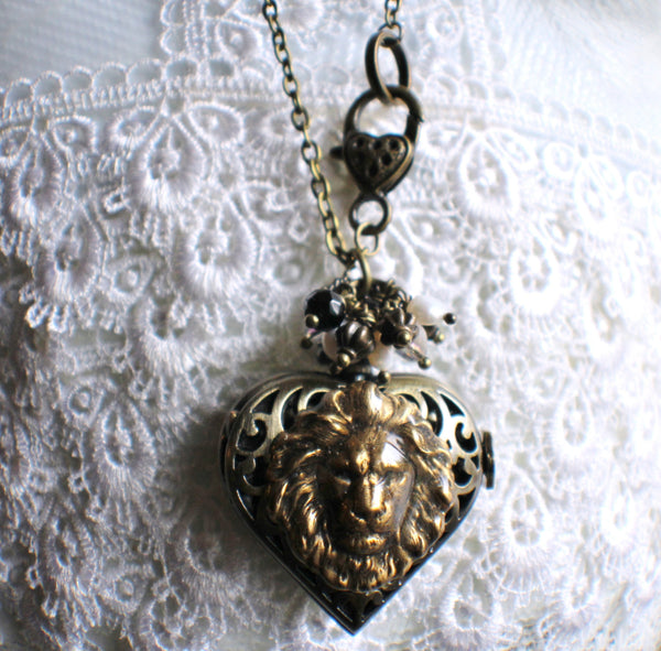 Heart watch locket in bronze with lion head mounted on front cover of watch. - Char's Favorite Things - 3