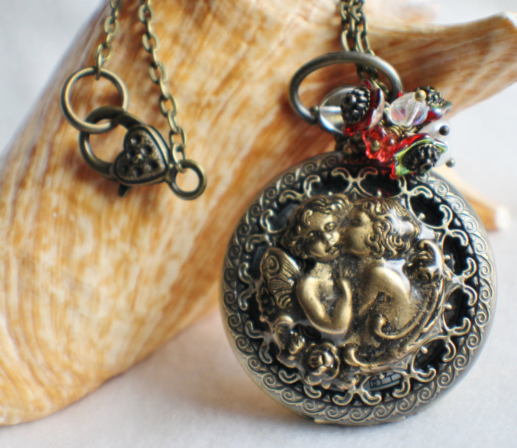 Cupid watch pendant, pocket watch with cupids mounted on front cover. - Char's Favorite Things - 1