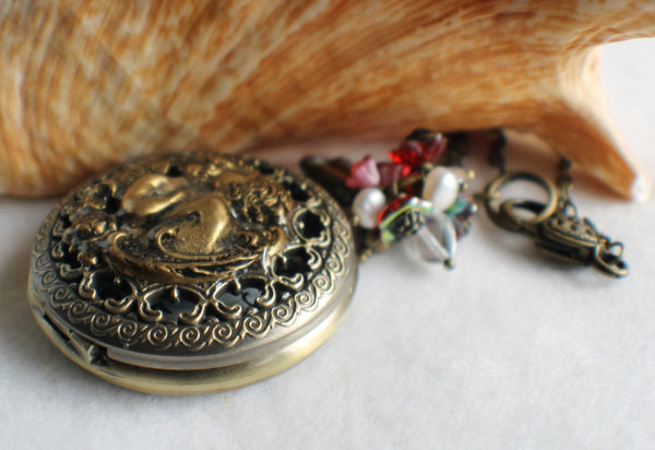 Cupid watch pendant, pocket watch with cupids mounted on front cover. - Char's Favorite Things - 2