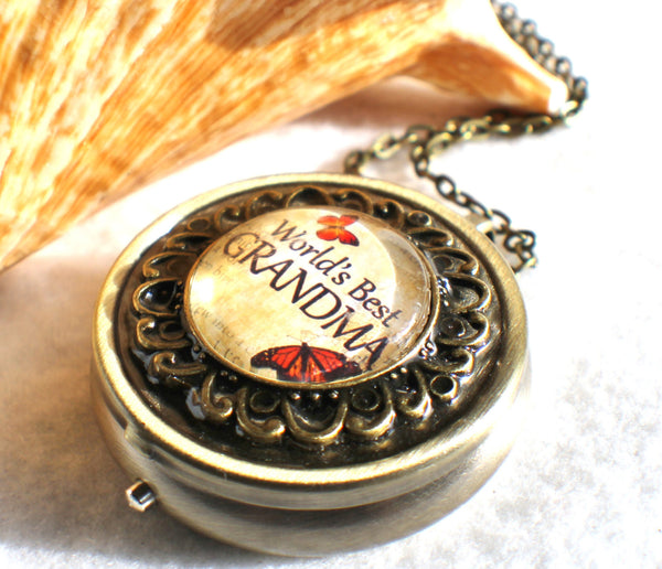 "Music box locket,  round locket with music box inside, in silver tone or bronze with ""World's Best Grandma"" on cover. - Char's Favorite Things - 2"
