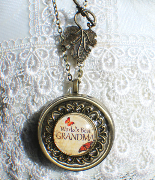 "Music box locket,  round locket with music box inside, in silver tone or bronze with ""World's Best Grandma"" on cover. - Char's Favorite Things - 4"