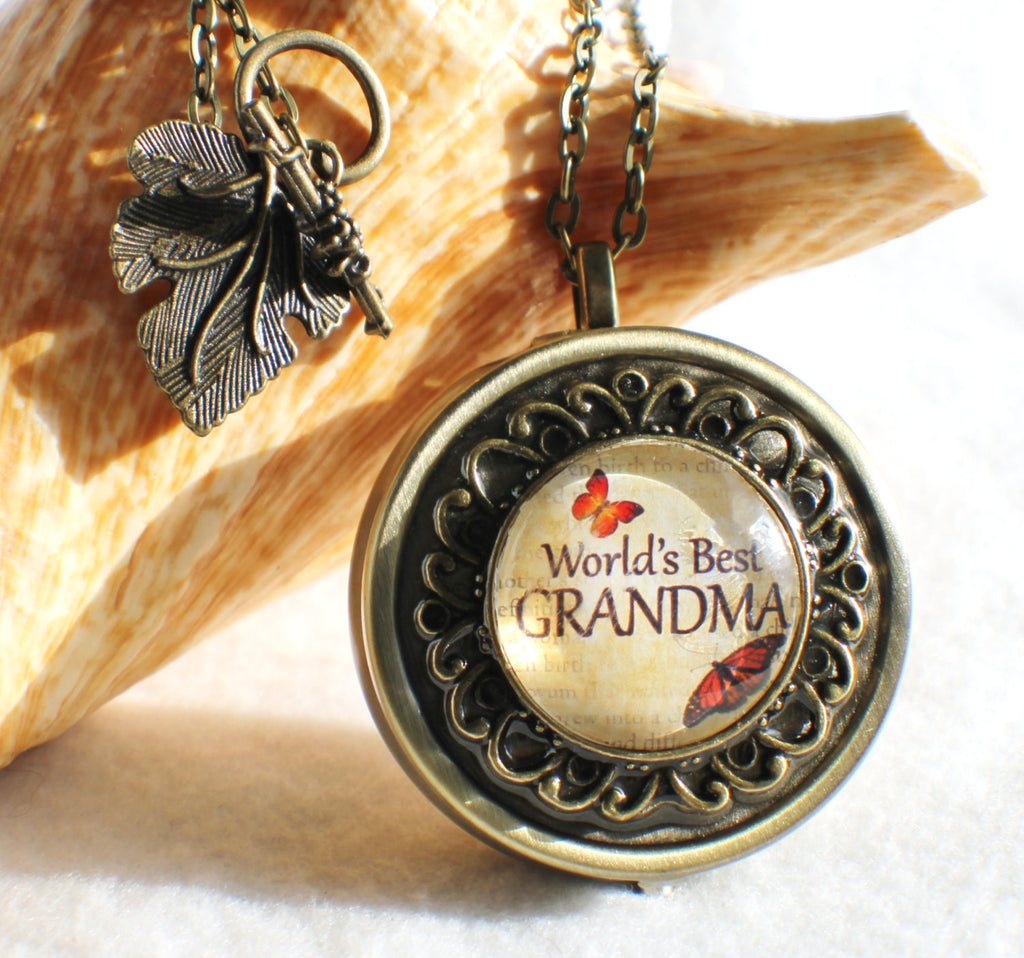 "Music box locket,  round locket with music box inside, in silver tone or bronze with ""World's Best Grandma"" on cover. - Char's Favorite Things - 1"
