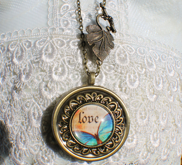 Music box locket, round locket with music box inside, in bronze with Love and Butterfly Cabochon - Char's Favorite Things - 4