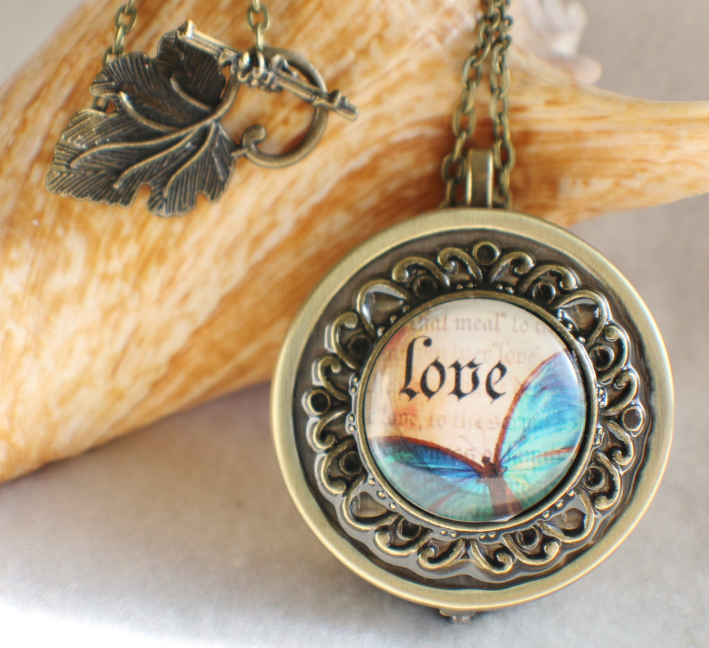 Music box locket, round locket with music box inside, in bronze with Love and Butterfly Cabochon - Char's Favorite Things - 1