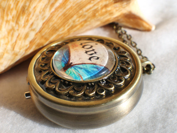 Music box locket, round locket with music box inside, in bronze with Love and Butterfly Cabochon - Char's Favorite Things - 2