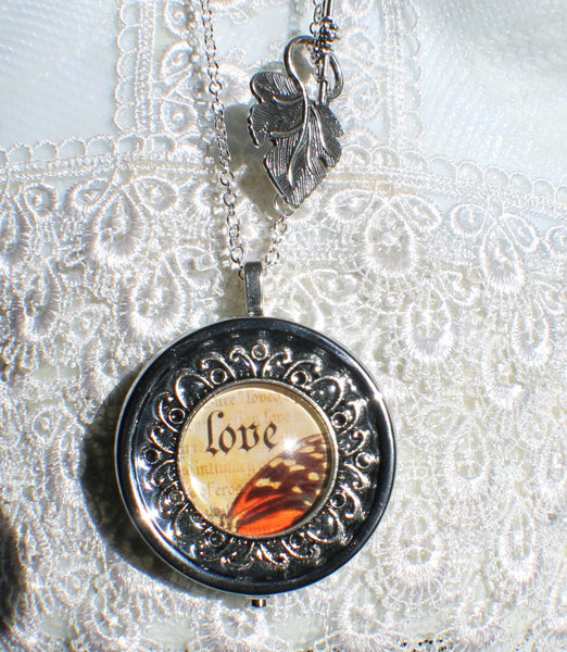 Music box locket, round locket with music box inside, in silver tone with Love and Butterfly Cabochon - Char's Favorite Things - 4