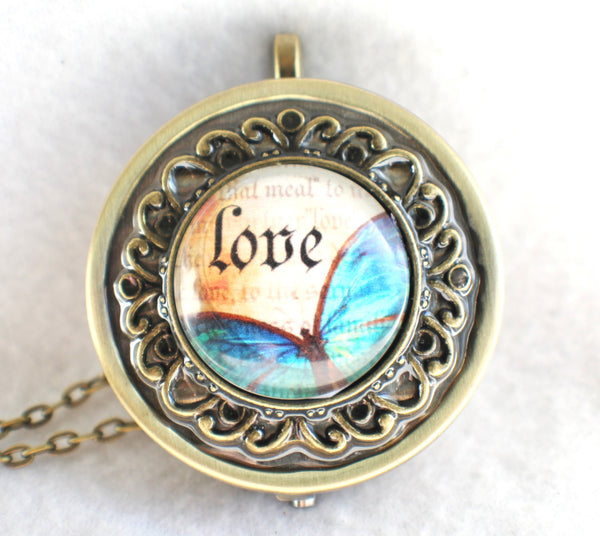 Music box locket, round locket with music box inside, in bronze with Love and Butterfly Cabochon - Char's Favorite Things - 3