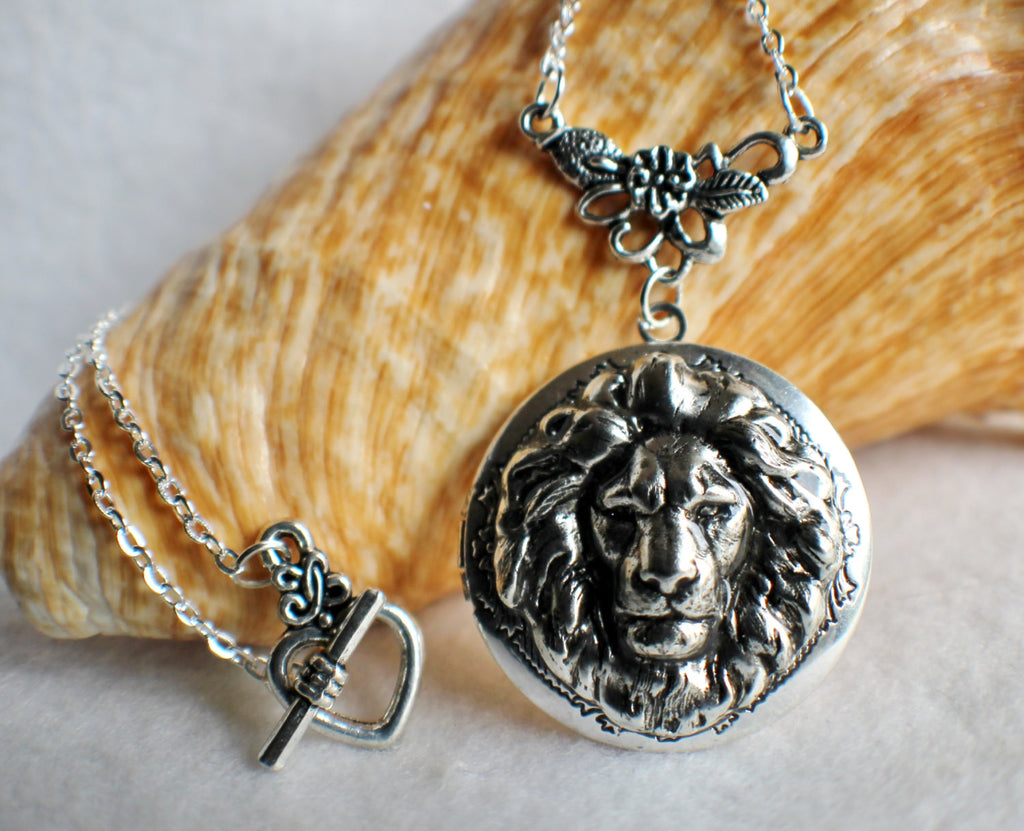 Lion photo locket, round silver tone locket with lion on front cover. - Char's Favorite Things - 1