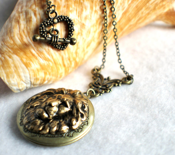Lion photo locket, round bronze locket with lion on front cover. - Char's Favorite Things - 2