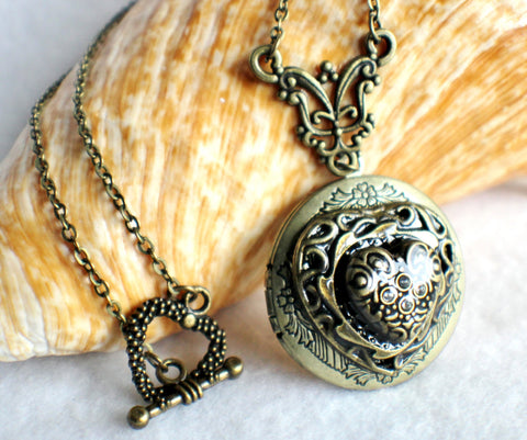 Heart photo locket, round bronze locket with stacked hearts on front cover. - Char's Favorite Things - 1