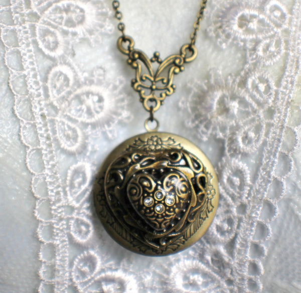 Heart photo locket, round bronze locket with stacked hearts on front cover. - Char's Favorite Things - 3