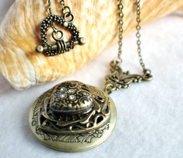 Heart photo locket, round bronze locket with stacked hearts on front cover. - Char's Favorite Things - 2