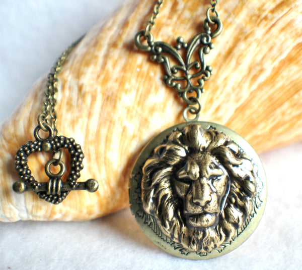 Lion photo locket, round bronze locket with lion on front cover. - Char's Favorite Things - 1