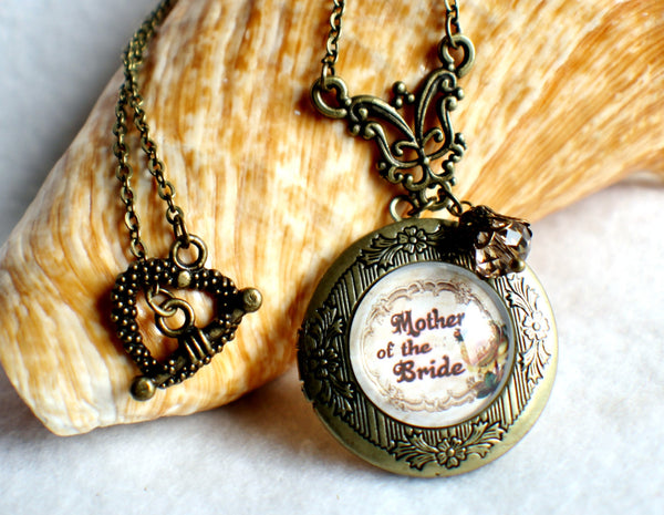 "Mother of the Bride photo locket, round bronze locket with glass cabochon and the words ""Mother of the Bride"" on front cover. - Char's Favorite Things - 1"