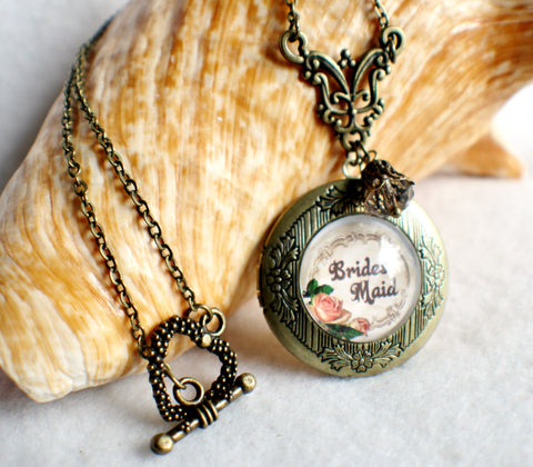 "Brides Maid photo locket, round bronze locket with glass cabochon and the words ""Brides Maid"" on front cover. - Char's Favorite Things - 1"