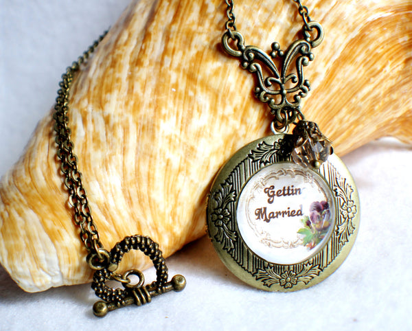 "Wedding photo locket, round bronze locket with glass cabochon and the words ""Getting Married"" on front cover. - Char's Favorite Things - 1"