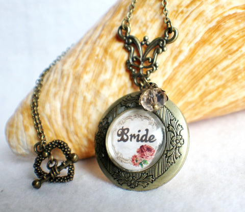 "Bride photo locket, round bronze locket with glass cabochon and the word ""Bride"" on front cover. - Char's Favorite Things - 1"