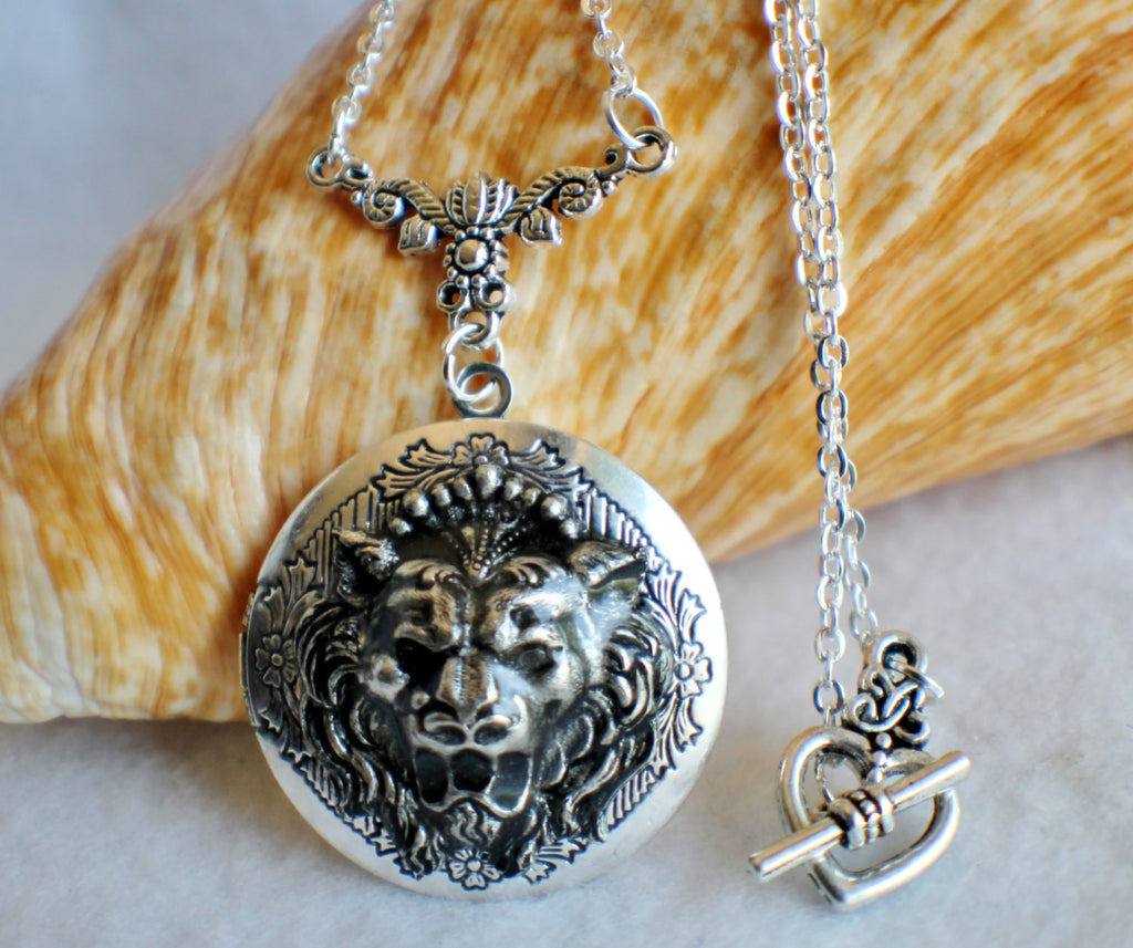 Lion photo locket, round silver tone locket with roaring lion on front cover. - Char's Favorite Things - 1