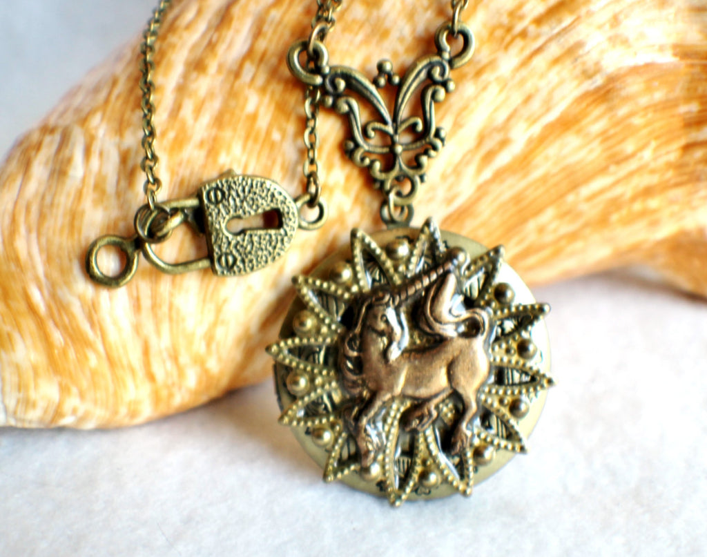 Unicorn photo locket, round bronze locket with unicorn and bronze filigree on front cover. - Char's Favorite Things - 1