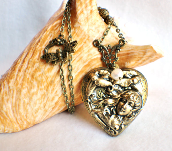 Victorian maiden photo locket, heart shaped bronze plated locket with Victorian maiden and lilies on front cover. - Char's Favorite Things - 1