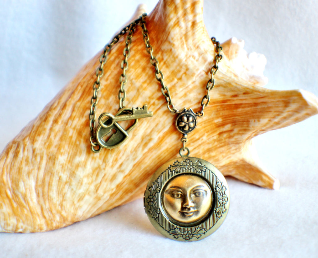 Moon photo locket, round bronze locket with moon man on front cover. - Char's Favorite Things - 1