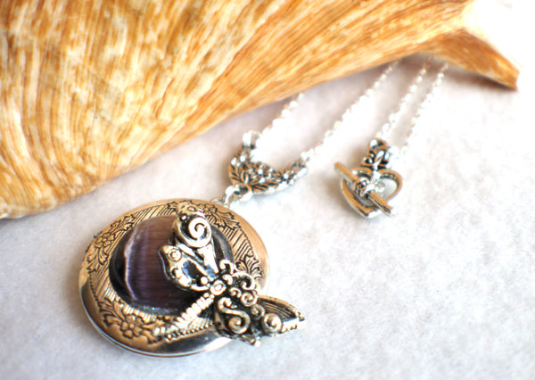 Dragonfly photo locket, round silver tone locket with purple cats eye cabochon and silver dragonfly on front cover. - Char's Favorite Things - 2
