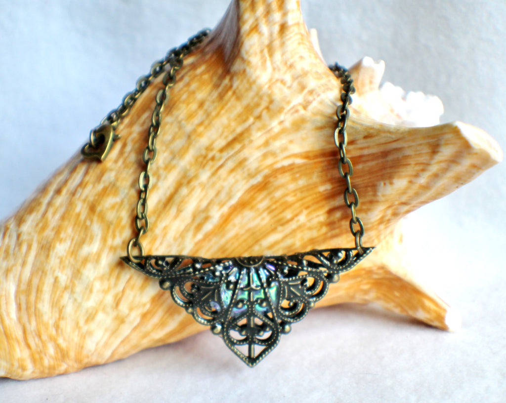 Triangle jewel necklace, bronze filigree triangle surrounds blue glass jewel. - Char's Favorite Things - 1