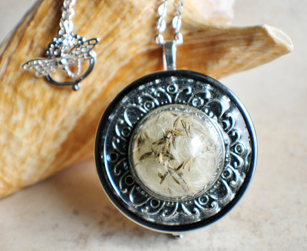 Music box locket,  round locket with music box inside, in silver with dandelion wishes encased in glass - Char's Favorite Things - 1