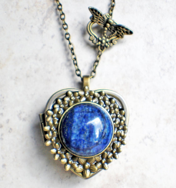 Music box locket,  heart shaped locket with music box inside, in bronze with lapis cabochon set in floral base on front cover. - Char's Favorite Things - 4