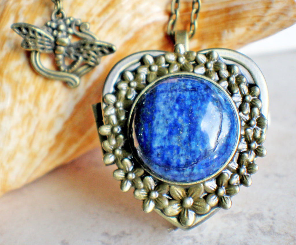Music box locket,  heart shaped locket with music box inside, in bronze with lapis cabochon set in floral base on front cover. - Char's Favorite Things - 1