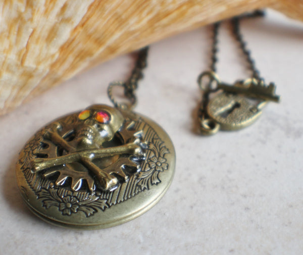 Skull and cross bones photo locket, round bronze locket with filigree and skull on front cover. - Char's Favorite Things - 2