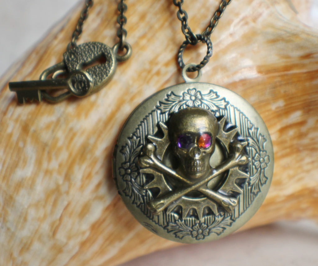 Skull and cross bones photo locket, round bronze locket with filigree and skull on front cover. - Char's Favorite Things - 1