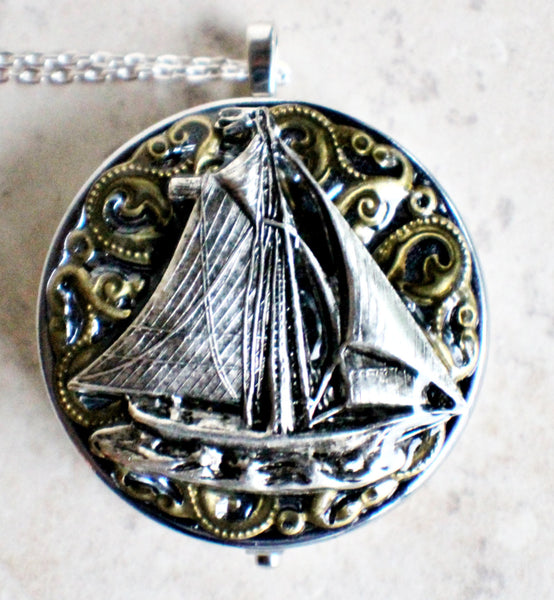 Music box locket, round silver tone locket with music box inside, with a nautical theme featuring a sailboat on front cover. - Char's Favorite Things - 3